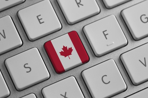 a computer keyboard with a Canada flag symbol symbolizing a letter writing campaign